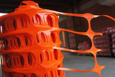 The detail of orange HDPE security fence