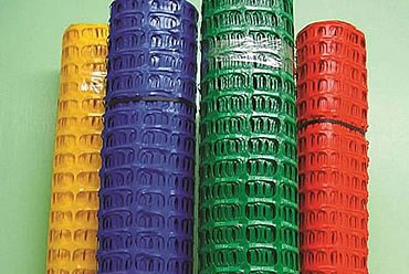 Four rolls of HDPE security fence in yellow, purple, green and red
