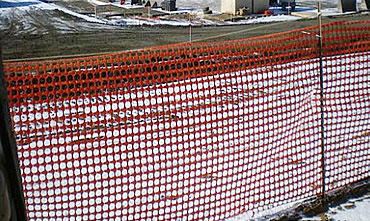 Heavy duty snow fence as barrier at construction site