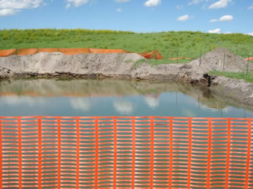 Orange snow fence used as groundwater open excavation