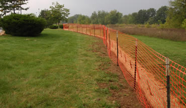 Orange snow fence used as protection barrier in horticulture