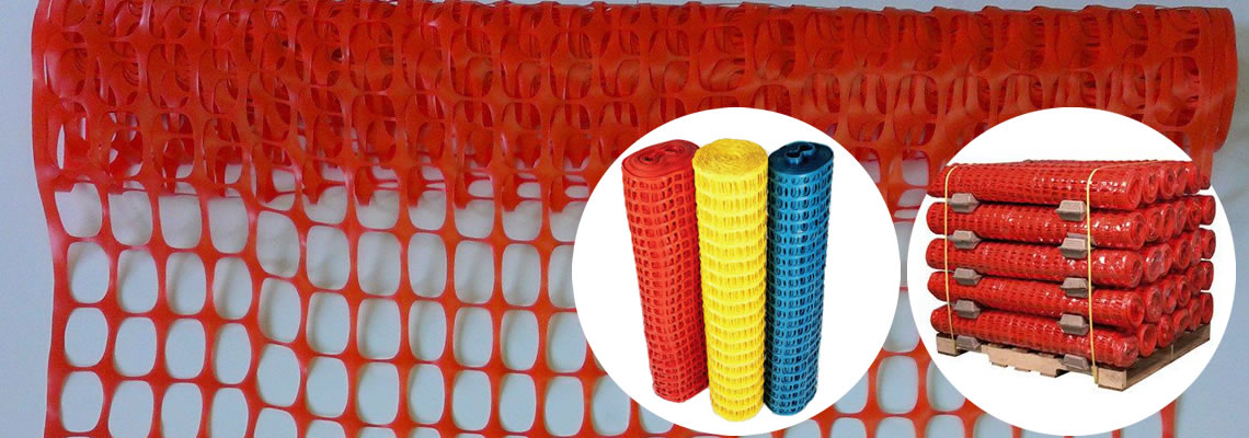 Rolls of red, yellow and blue snow fences and package